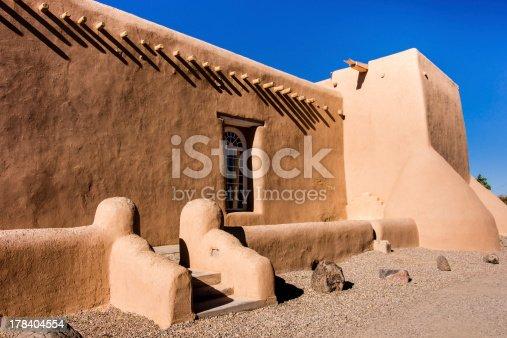 Exterior of San Fernando de Assisi church in Taos, New Mexico made famous by Ansel Adams.