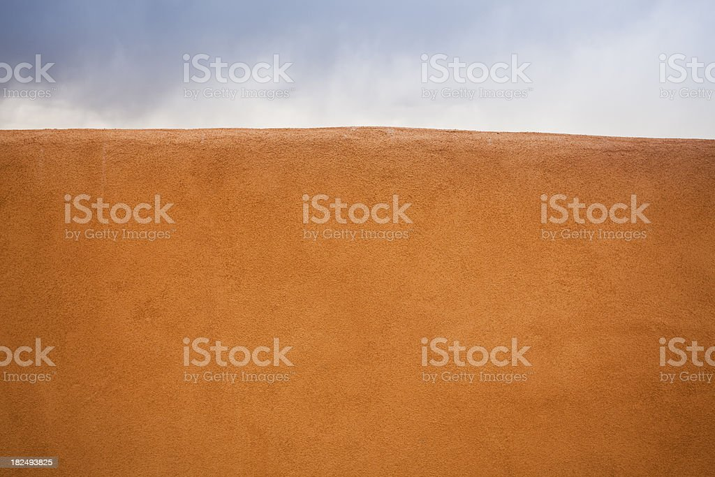 Adobe clay wall with a sky royalty-free stock photo