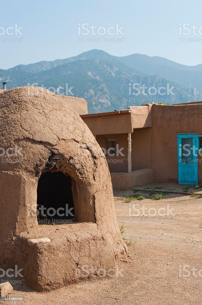 Adobe Horno, Pueblo and Mountains stock photo
