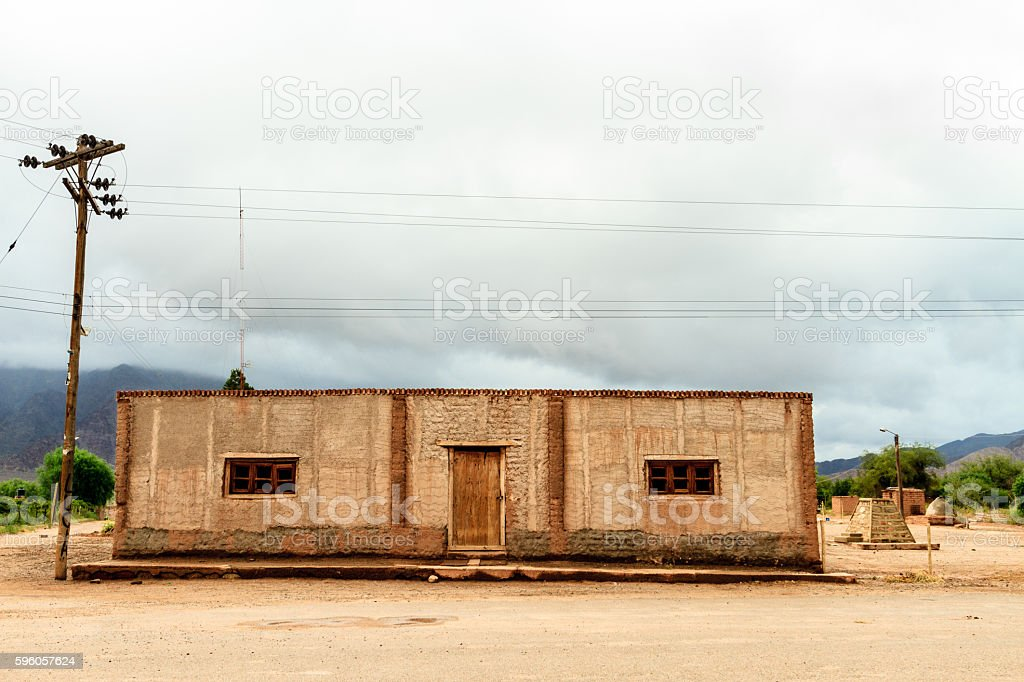Adobe house in front of mountains in Catamarca, Argentina royalty-free stock photo