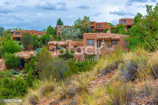 Pueblo style homes on a hillside in Santa Fe, NM.