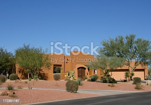 Adobe salmon colored home in upscale Arizona neighborhood