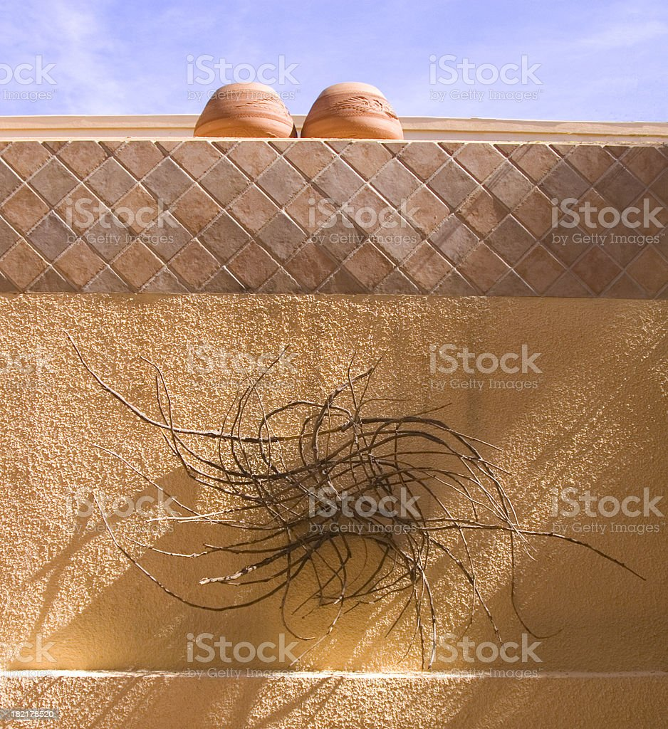 Adobe pots and stick sculpture royalty-free stock photo