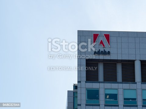 SAN JOSE, CA - APRIL 14, 2018: Adobe Systems, Photoshop maker, logo on headquarters skyscraper towers in Silicon Valley