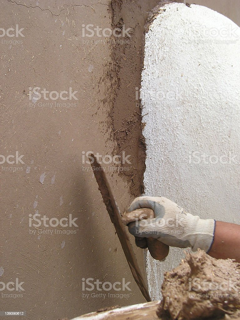 Adobe trowel application royalty-free stock photo