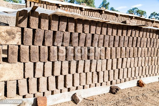 Adobes or bricks in the process of drying prior to being burned in a wood-burning oven