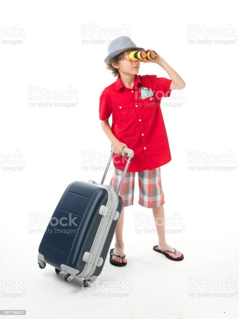 Adolescente posando com binóculos e mala - foto de acervo