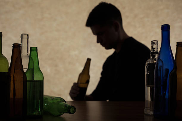 Adolescent drinking beer stock photo