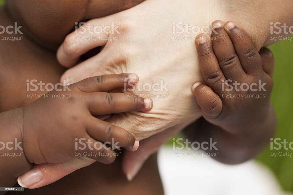 Adopted Son Touching His Mother's Hand stock photo