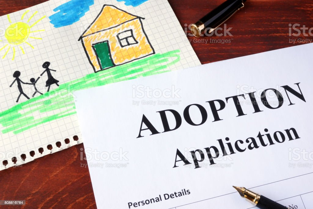 Adoption form and children's picture. (I am owner of picture.) stock photo
