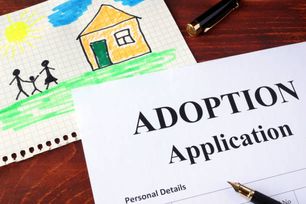 Adoption form and children's picture. (I am owner of picture.) Adoption form and children's picture. (I am owner of picture.) AM stock pictures, royalty-free photos & images