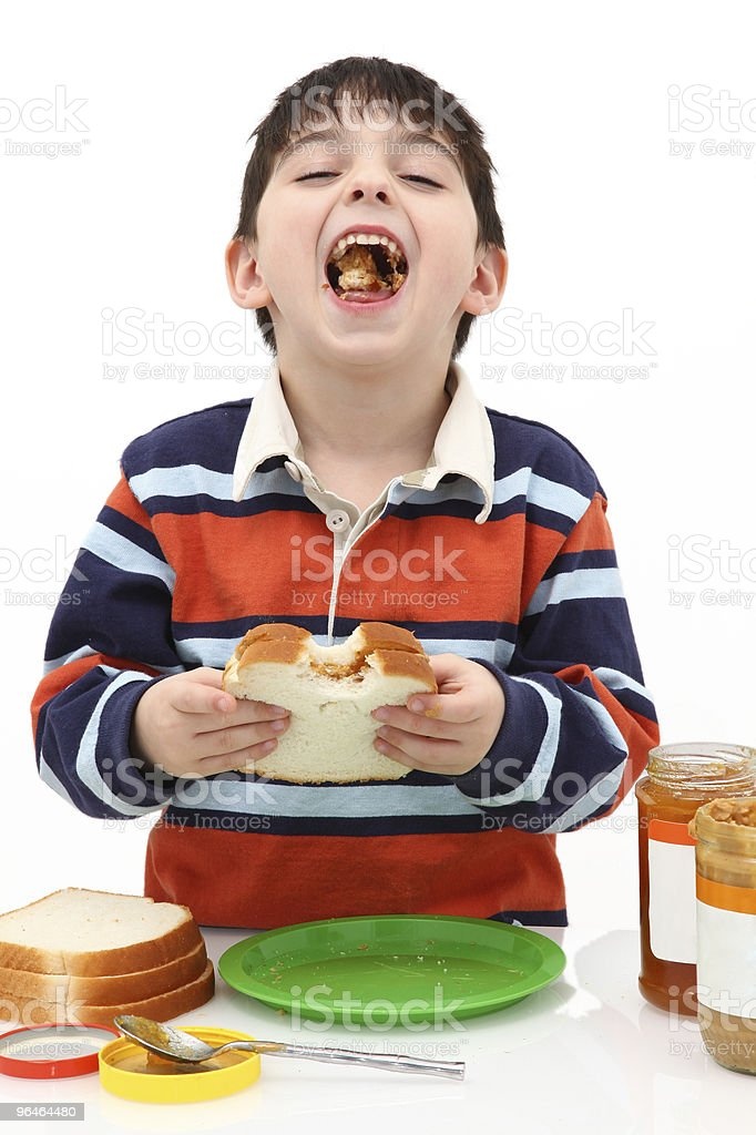 Adorabel Boy Eating Peanut Butter and Jelly sandwich royalty-free stock photo