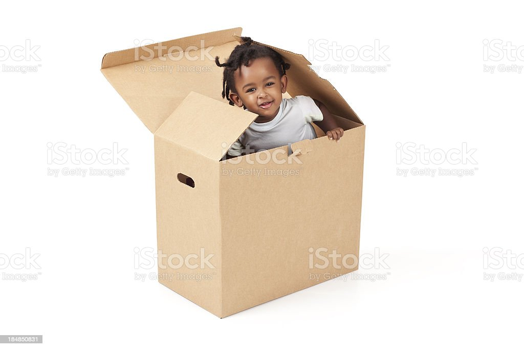 Adorable 2-3 years old baby leaping out of a box. royalty-free stock photo