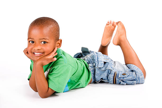 Adorable 3 year old black or African American boy stock photo