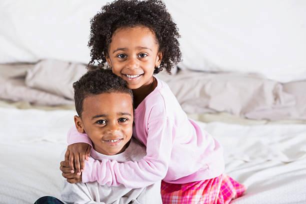 Adorable African American children wearing pajamas stock photo