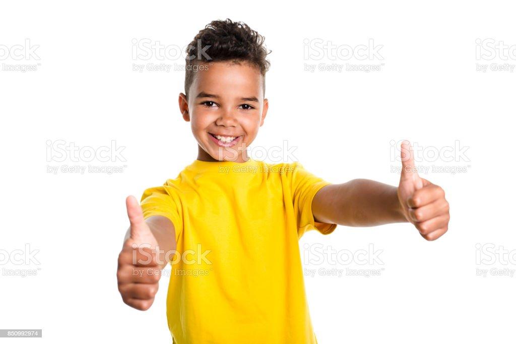 Adorable african boy on studio white background stock photo