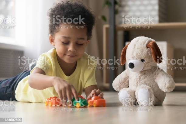 Adorable african kid lying on warm floor play with toys picture id1153592599?b=1&k=6&m=1153592599&s=612x612&h=l1tblmlsrdlwpjdecawp7lashkw9uxfqbltnne4jabg=