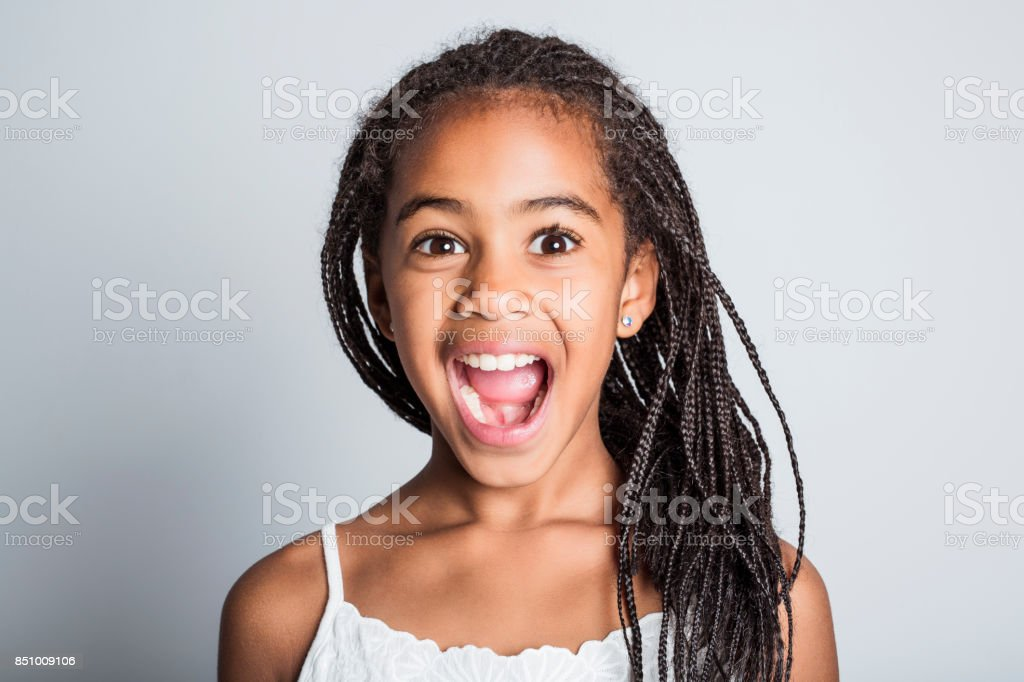 Adorable african little girl on studio gray background stock photo