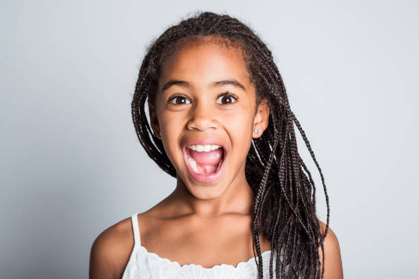 Adorable african little girl on studio gray background An Adorable african little girl on studio gray background 8 9 years stock pictures, royalty-free photos & images