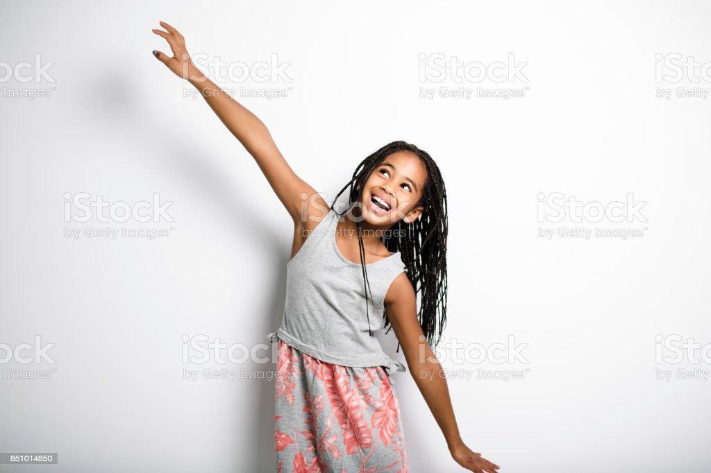 Adorable african little girl on studio gray background stock photo