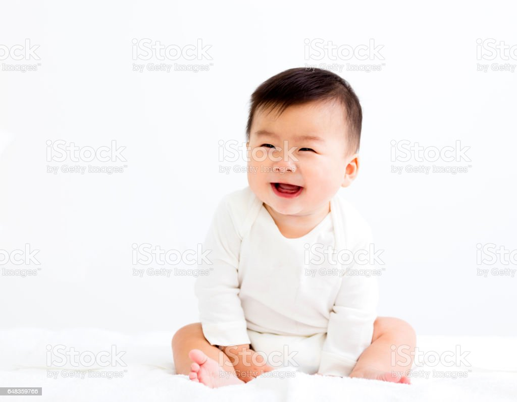 Adorable asian   smiling  baby  boy stock photo
