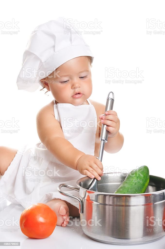 Adorable baby boy chef sitting and playing with kitchen equipment - Stock  image . 5598a7b22176