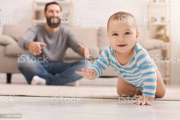 Adorable baby boy crawling on floor with dad picture id1135976569?b=1&k=6&m=1135976569&s=612x612&h=f7yosrymhykkfsa4m3akduau83e2ddzo4ep7t0m7wbu=