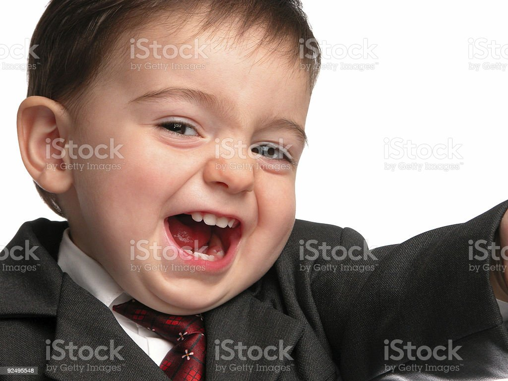 Adorable Baby Boy in Suit Flashing that Salesman Smile royalty-free stock photo