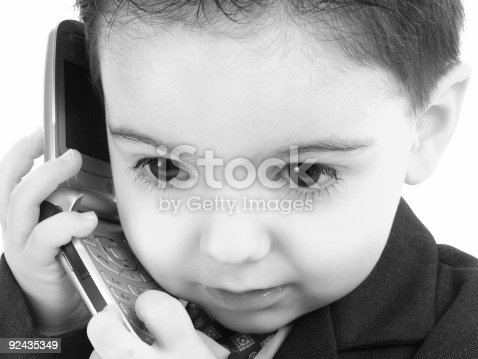 9515990ff Adorable Baby Boy In Suit On Cellphone In Black And White Stock ...