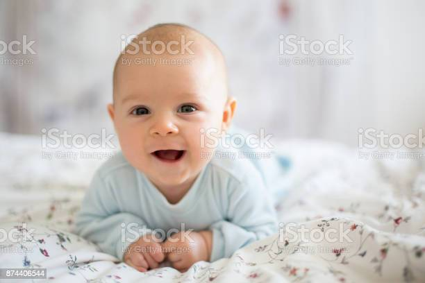 Adorable baby boy in white sunny bedroom in winter morning picture id874406544?b=1&k=6&m=874406544&s=612x612&h=bnd64gkuzcihq7endtqygd8lhl8jjihfggcc1 m6v4g=