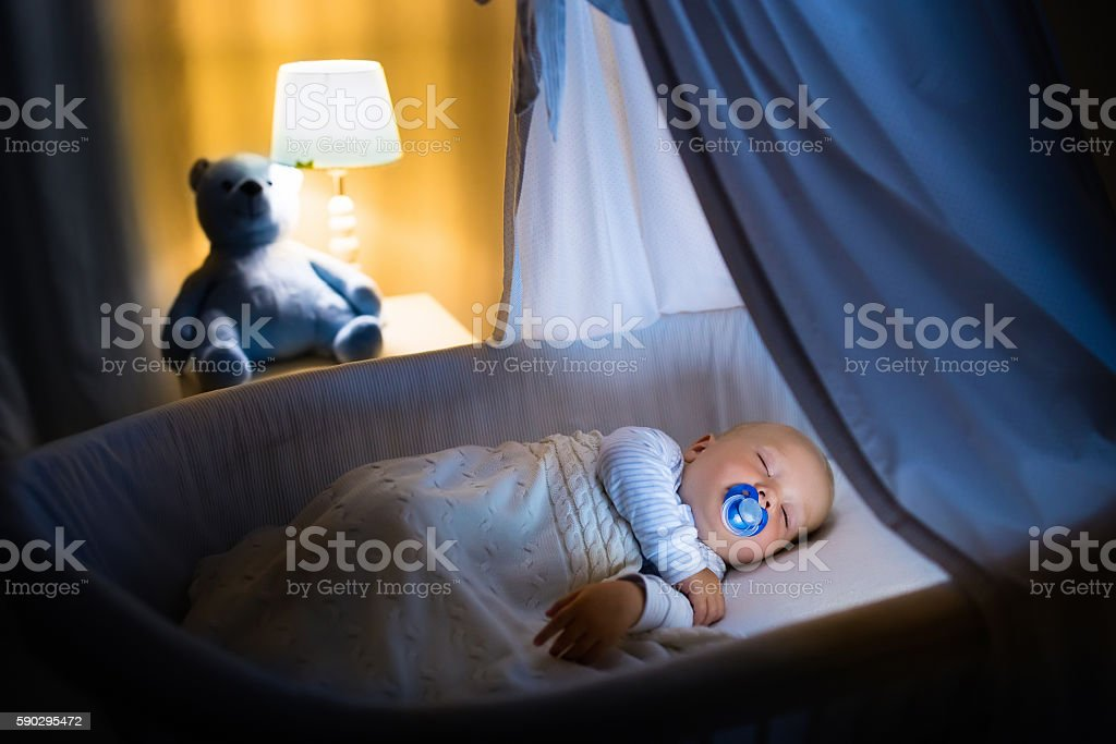 Adorable baby boy sleeping at night royaltyfri bildbanksbilder
