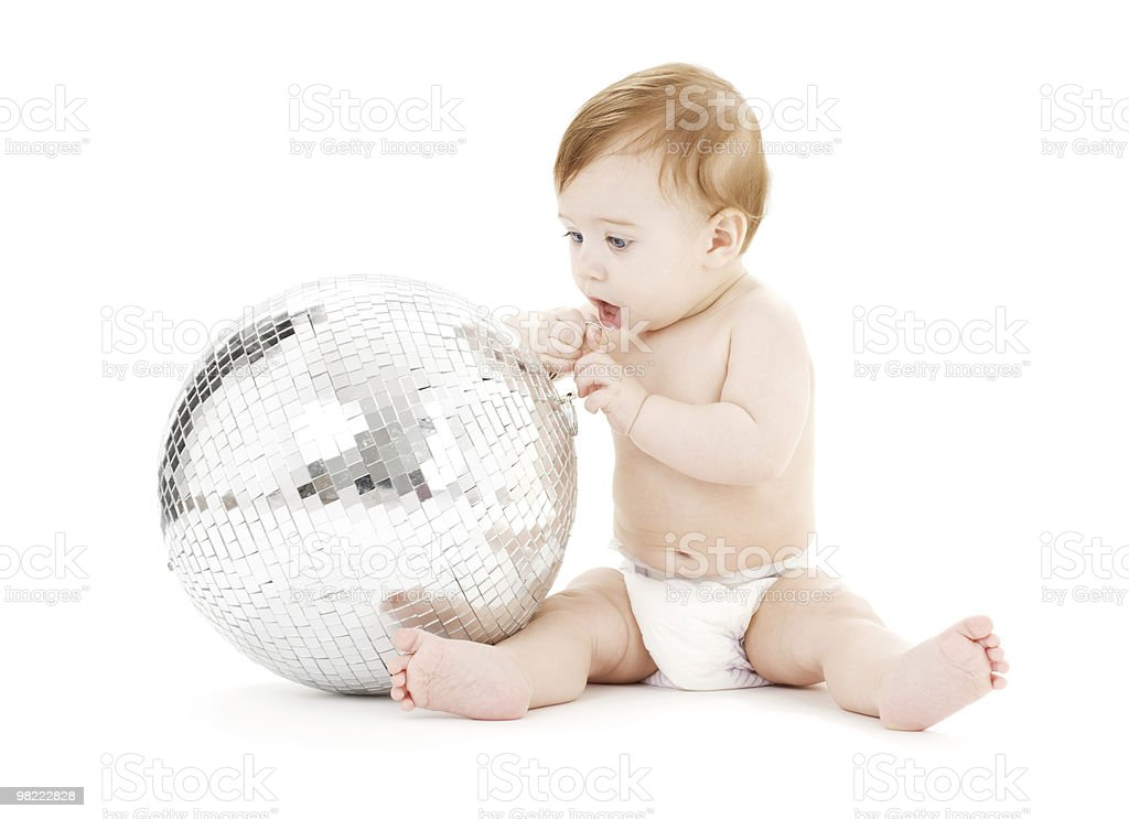 adorable baby boy with big disco ball royalty-free stock photo