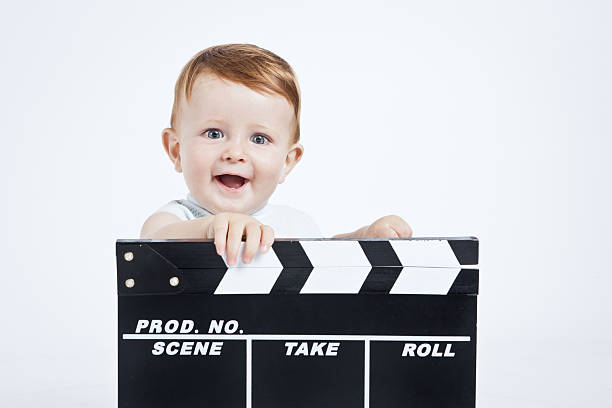 Adorable baby cine director. stock photo