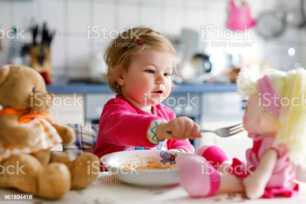 Adorable baby girl eating from fork vegetables and pasta little child picture id961894418?b=1&k=6&m=961894418&s=612x612&h=c1pvatzph5tebbi95kgdm3uvx2d7sumbvu74vr 7gpw=
