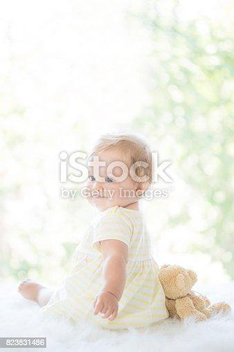 istock Adorable baby girl on fluffy blanket 823831486