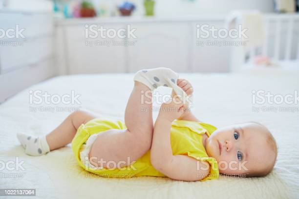 Adorable baby girl removing sock from her foot picture id1022137064?b=1&k=6&m=1022137064&s=612x612&h=az2g8nhvsp1gw5zxqz8lysnzi8t0a4dnhbxvzcfrfmm=