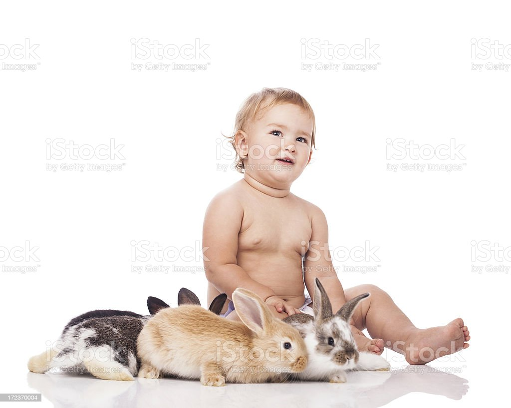 Adorable baby girl with bunnies royalty-free stock photo