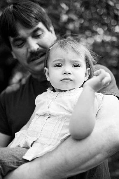 Adorable Baby Girl with Caucasian Single Dad, Black and White stock photo