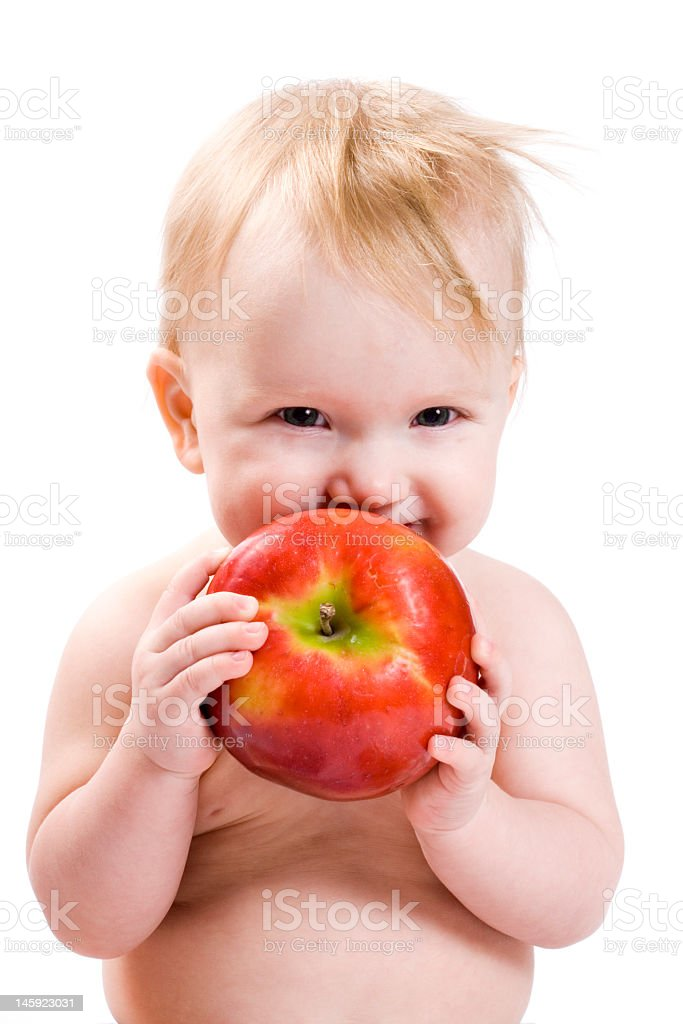Adorable baby holding red apple royalty-free stock photo