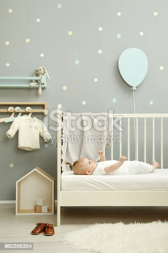 istock Adorable baby in the white outfit in the nursery 960356354