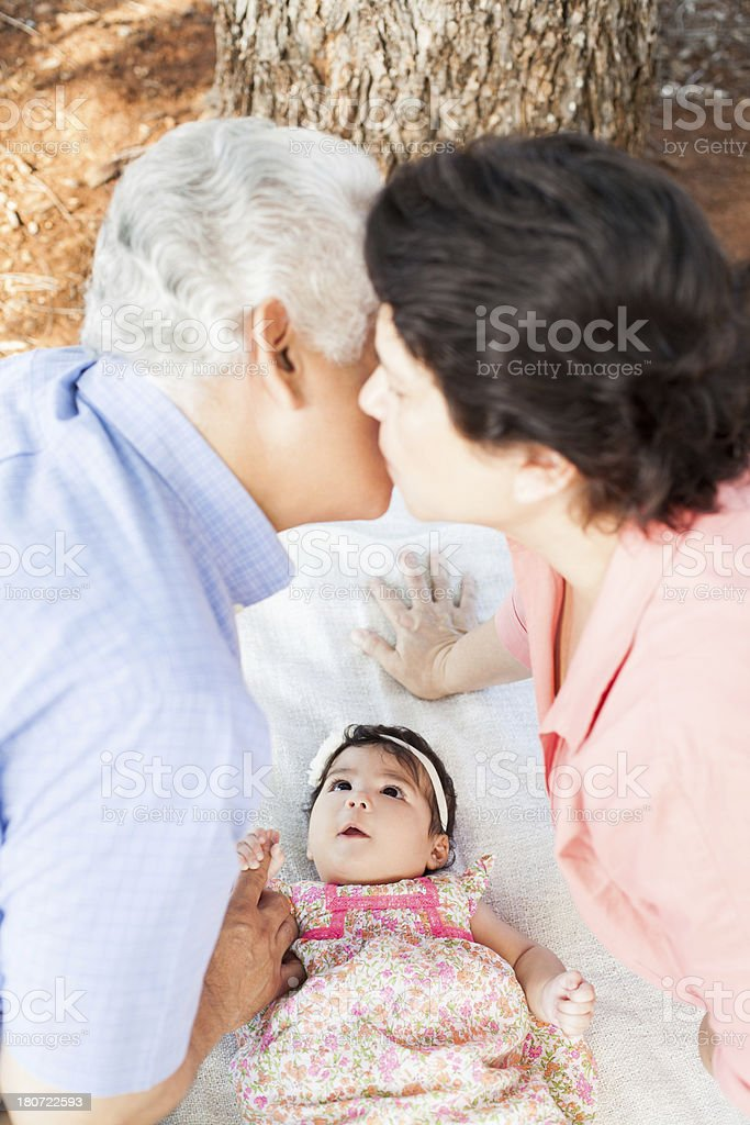 Adorable baby looking at granparents royalty-free stock photo