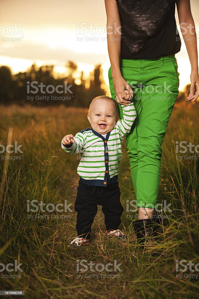 Adorable baby walking around with mother royalty-free stock photo