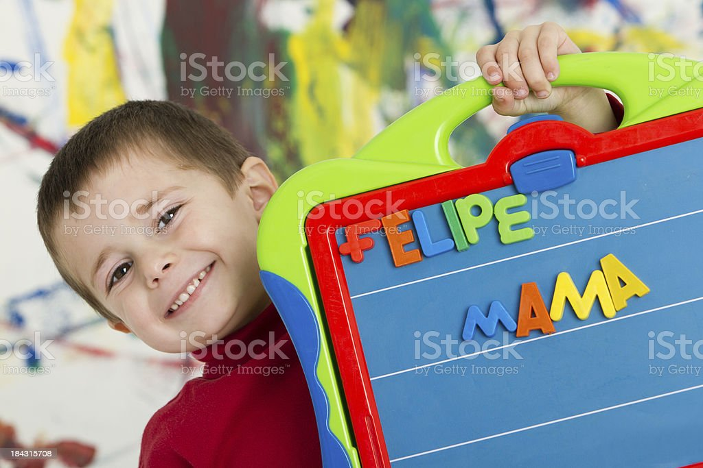 Adorable boy learning the letters in spanish royalty-free stock photo