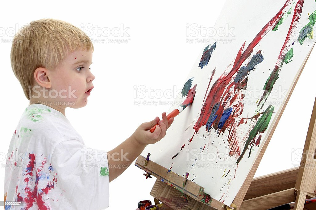 Adorable Boy Painting At Easel royalty-free stock photo