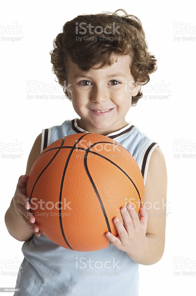 adorable boy playing the basketball royalty-free stock photo