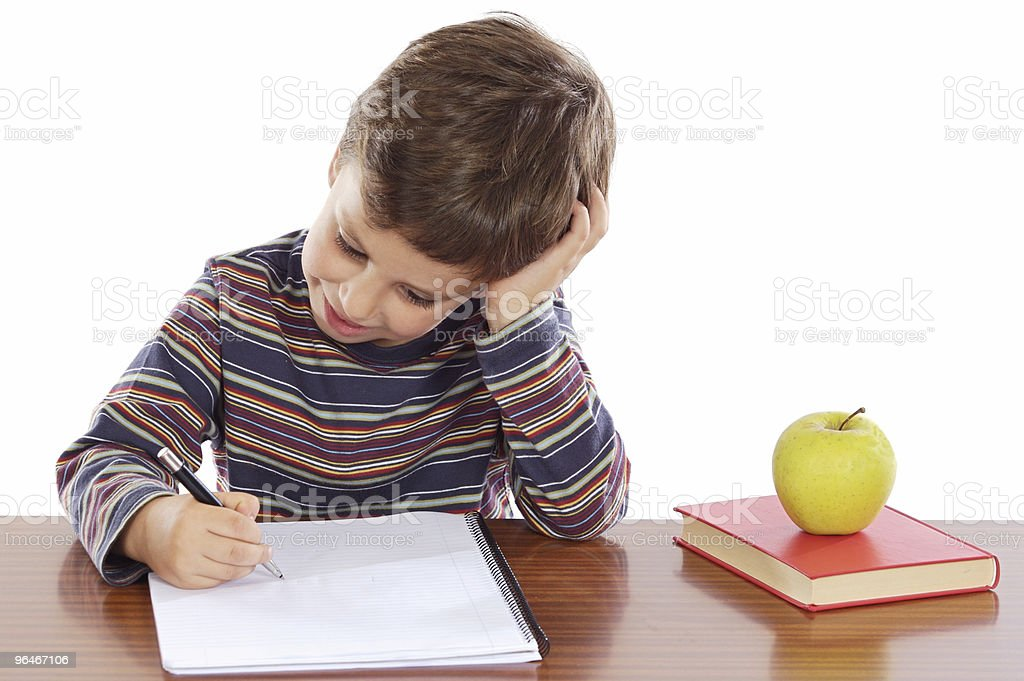 adorable boy studying royalty-free stock photo