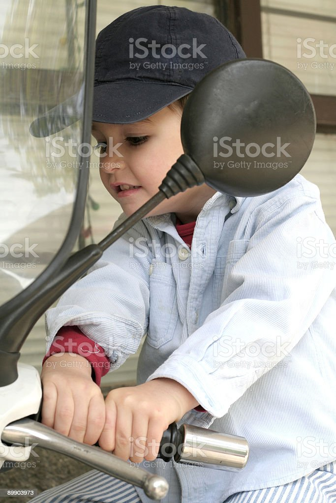 Adorable Boy trying to brake royalty-free stock photo