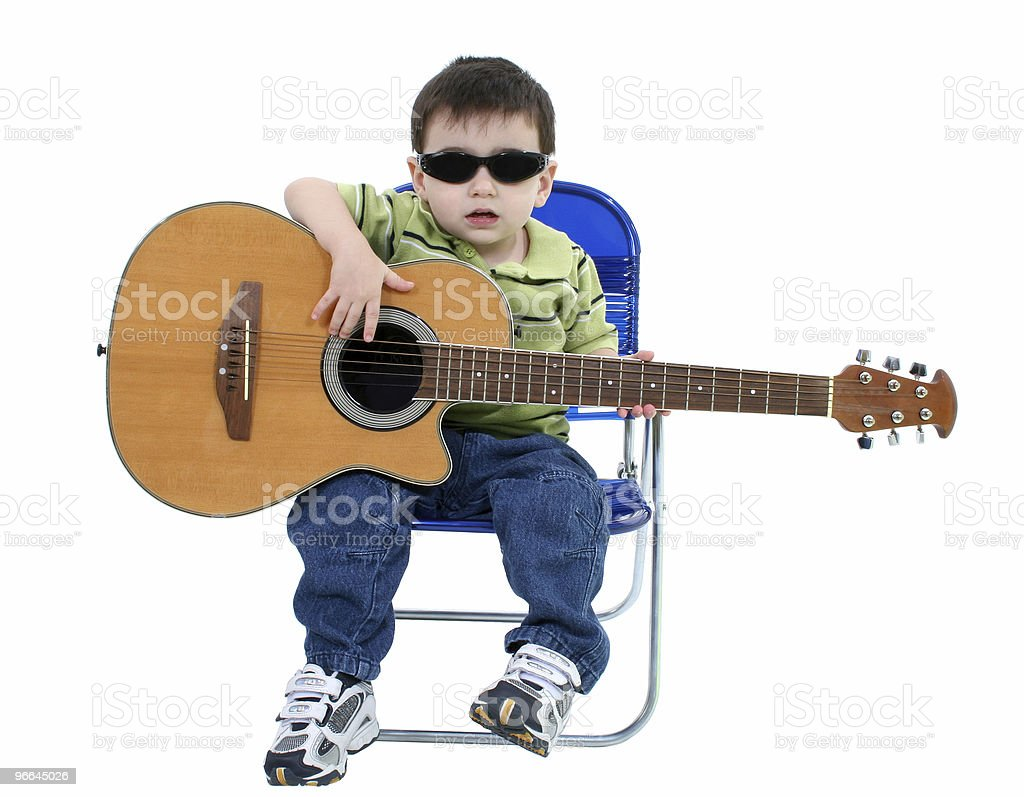 Adorable Boy With Sunglasses And Acoustic Guitar Over White stock photo