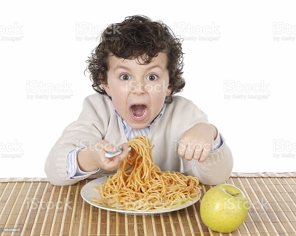 Adorable child hungry at the time of eating royalty-free stock photo