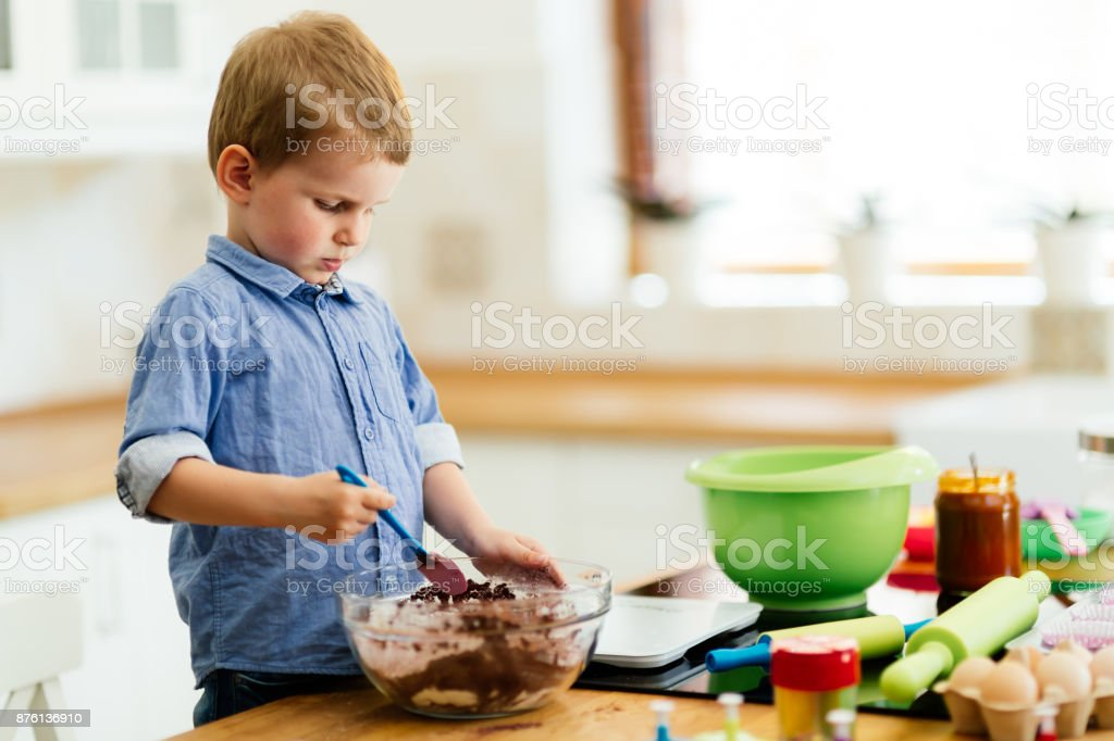 Adorable child making cookies stock photo